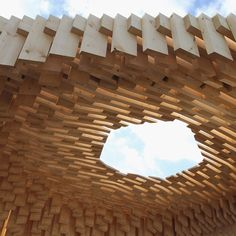 Wooden pavilion by architect David Adjaye.  Love this 3D fade effect with the light filtration.