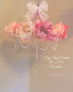 make a faux chandelier out of strung beads, flowers glued all around and a ribbon on top