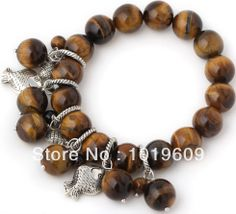 Aliexpress.com : Buy Free Shipping pretty style brown color tiger eye beaded bracelet with Tibet silver fish charm from Reliable Special Sto...