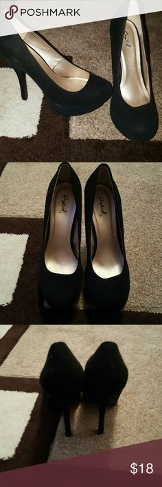 Black faux suede pumps Black faux suede pumps size 7- platform in the front for more comfort. Qupid Shoes Heels