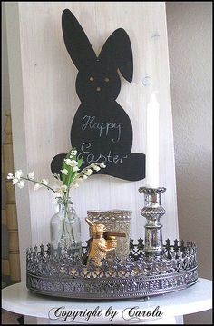 My dad cut the wooden bunny shape for me years ago and recently I painted it with chalkboard paint.