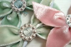 Make velvet bows and stitch to hair pins.
