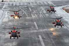 Coast Guard Jayhawk rescue helicopters flying in formation