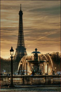 Place de Concorde fountain at dawn with the Effel tower in the background in Paris