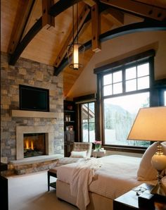 I would do a lot of things to have this going on right now! Cozy Rustic Chalet Bedroom # fireplace bedroom