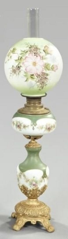 lighting, Germany, A Dresden porcelain kerosene parlor lamp, fourth quarter 19th century, the gilded cast-iron-mounted enameled and parcel-gilt lamp in the Louis XVI taste, retains the period blown glass chimney and floral-enameled spherical white opal glass shade.