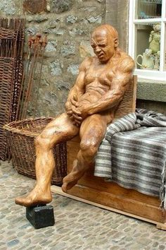 This awesome full size man wood carved sculpture was done from one single piece of oak by the amazing British sculptor Thomson Dagnall.