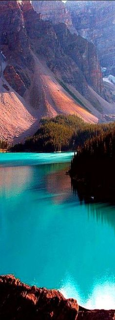 The turquoise waters of Moraine Lake nestled in the Canadian Rockies.