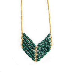 """Our funky and boho Eve necklace in evergreen adds quirky but subtle detail  to any outfit, whether it's a floaty maxi dress or your favorite tank.  The details:Approximately 30"""". Claspless."""