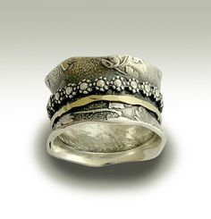 Sterling silver band with silver and gold spinners  by artisanlook,