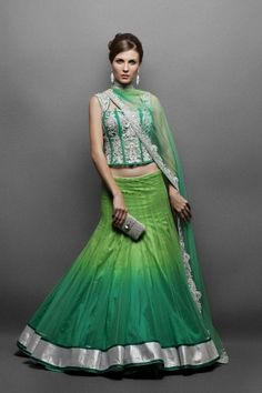 Beautiful shades of green, with silver. And that super cute clutch! #wedding #lehenga