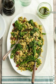 This gluten-free orzo pesto pasta salad with broccolini and sun-dried tomatoes is vegan-friendly and a flavorful addition to any picnic or potluck.