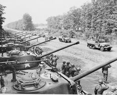 Major General Frank Parks General George Patton Colonel W. H. Kyle J. J. McCloy H. H. Bundy and US Secretary of War Henry Stimson reviewing US 2nd Armored Division Berlin Germany 20 July 1945.