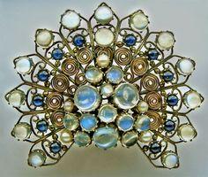 DORRIE NOSSITER 1893-1977,Arts & Crafts Peacock Clip,Silver, Gold, Moonstone, Sapphire, &Pearl;British, c.1930
