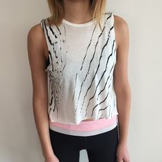 [all saints] white animal pattern top This semi-sheer white crop top is shorter in the front than in the back. The print is animal-like and will look especially great with culottes, cut-offs, or leggings. Get ready for spring! 100% viscose. So super duper soft. Excellent condition. All Saints Tops Tank Tops