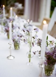 Simple but sensual arrangements of sweet peas, lavender and purple heather set the scene for the summery affair held inside and out of Suzanne Kasler's Regency-style estate. The lush setting, complete with casual and formal touches, created a convivial atmosphere for mingling business and pleasure.