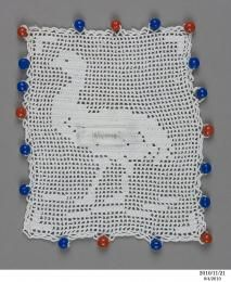 Filet crochet 'emu' milk jug cover, 1910 - 1930