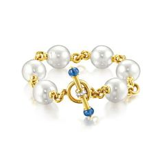 Verdura Pearl Toggle Bracelet South See cultured pearl, sapphire, diamond and gold.