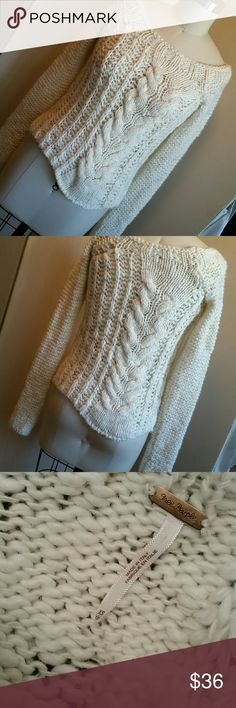 Free People Asymmetrical Italian Sweater XS Cream/ivory color, loose knitted acrylic 50%, wool 40%, mohair 10%. Side slits. Cable knit off center keeps 'em wondering ?? Nice scoop neckline with narrow shoulder. Free People Sweaters Crew & Scoop Necks
