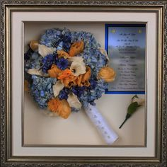 preserved wedding bouquet with invitation and boutonniere in a 16x16 antique silver shadow box.