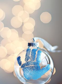 Glitter-&-glue kiddie's handprint bauble: What a fab little craft idea to get, er, stuck into closer to Christmas time! Would make a lovely pressie for doting grannies, grandpas, aunties, etc :)