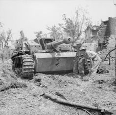 BRITISH ARMY ITALY 1944 (NA 15178) Troops examine a knocked-out German StuG III assault gun near Cassino, 18 May 1944. Two 75mm AP rounds from a Sherman tank have neatly penetrated its front armour.