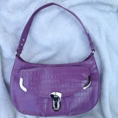 MAXX NEW YORK Purple Leather Hobo This bag is in really good shape on the exterior.    The lining has no rips or tears, but the fabric has a little soil spot from opening.  It has one large pocket in the inside with the smaller zip side pocket.  It also has a pocket on the outside on both sides. MAXX NEW YORK Bags Hobos