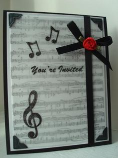 This is the outside of my daughter's recital invitations.  The sentiment is computer generated.  The music score in the background is a stamp.  I covered it with vellum, and stamped more music notes.  The photo corners hold the vellum in place. _________________________________________ For more creative inspiration, visit my [url=http://amyscreativepursuits.blogspot.com/] BLOG [/url]