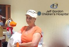 """Author Nancy B. Brewer at Jeff Gordon Children's Hospital - showing off the goose from """"The Princess and the Goose"""" get this book on Kindle now FREE"""