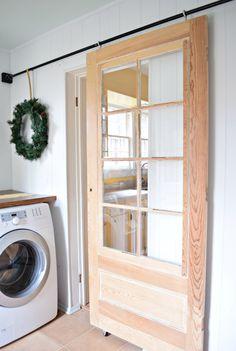 Beautiful vintage wood door turned into a sliding barn door! www.houseologie.com