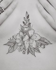 Floral fineline sternum tattoo by Tritoan Ly