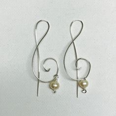 Made a pair of silver wire Treble Clef earrings with freshwater pearls!
