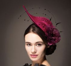 Black beaded wire arches sweep up from the centre of the large hand painted silk flower enhancing the unusual shape of this highly original cocktail hat. See...