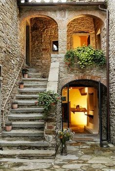 Tuscany - Italy I love that everything is made of stone and greenery everywhere.