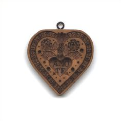 """""""Amo Te"""" (Latin for """"I Love You"""") Heart Cookie Mold.  $23.00 on House on the Hill website."""