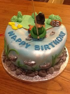 Fishermans cake for my Dads 65th birthday. He is a keen angler. I handmade the fish, rocks, bait box and even his flask that fell in the water one day!