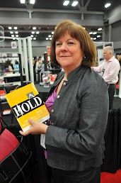 Mega Camp attendee waiting to get advanced copy of HOLD signed.