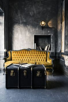 dark gray interior with ochre yellow sofa, mustard yellow