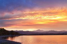 An epic sunset that lasted over an hour long along the front range of the Colorado Rocky Mountains with a view over McIntosh Lake of the Twin Peaks, Mt Meeker 13,911 ft and Longs Peak 14,256 ft. Boulder County. Fine art photography prints, decorative canvas prints, acrylic prints, metal Prints wall art  for sale on FineArtAmerica.com. Prints starting at $25. Copyright: James Bo Insogna