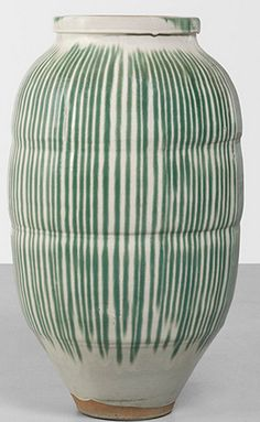 JAPANESE  massive water vessel (tsubo)  1860  vertical green drip over cream glaze on stoneware19 dia x 34 h inches    This early Meiji period vessel is from the Shigaraki Kiln region; the Shigaraki Kiln is one of six ancient kilns in Japan.