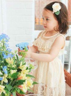 Cream sleeveless lace dress with a stretch waist