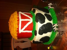 Barn and cow cake side view