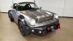 with aluminium statement bumpers, a HID hella light pod and suspension equal to that used on the top FIA world rally cars, a HID hella light pod, the porsche 964 'safari' is the rally car of dreams.