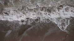 breaking whitecap washing shore beach sand lace foam ocean waves - Stock Footage | by ionescu
