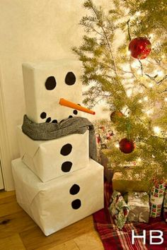 Put gifts wrapped separately in three boxes  Box snowman