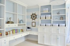 blue and white nautical nursery - built in shelving unit