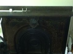 Really old marble fireplace in my apartment. Can't use it though :(