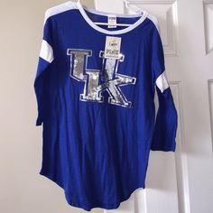 Sequin Kentucky Top Blue and white UK Kentucky Top from Victoria's Secret with silver sequins. Such a cute quarter sleeve top brand new never worn, rare top. Just trying to down size my closet, I have so many UK items lol. Trying to get back what I paid. PINK Victoria's Secret Tops