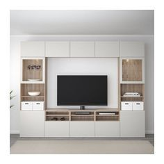IKEA - BESTÅ TV storage combination/glass doors walnut effect light Ikea Tv Wall Unit, Built In Tv Wall Unit, Wall Units For Tv, Tv Built In, Tv Wanddekor, Living Room Tv Unit Designs, Tv Wall Unit Designs, Living Room Wall Units, Tv Wall Decor