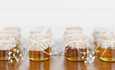 small honey jar wedding favors with lace and burlap
